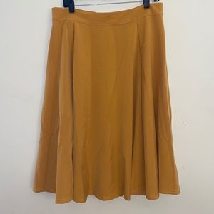Rock Steady mustard mid length button back skirt